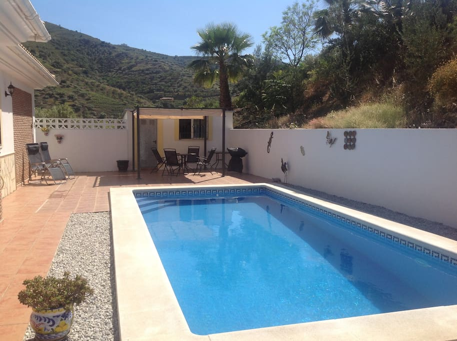Swimming Pool with shaded area also second outdoor eating area