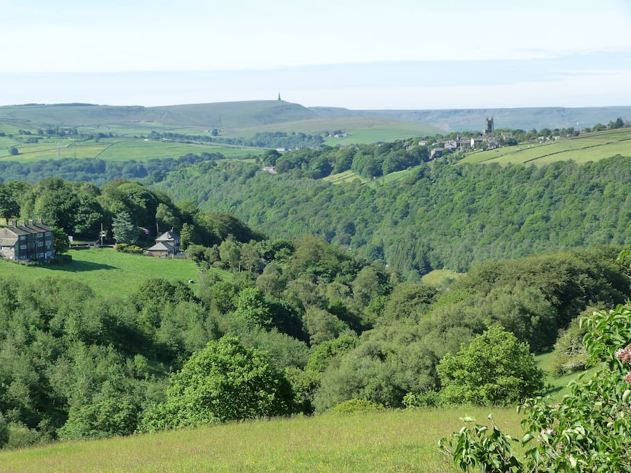 Breathtaking view from Elmet Farmhouse across Hardcastle Crags towards Heptonstall and Stoodley Pike