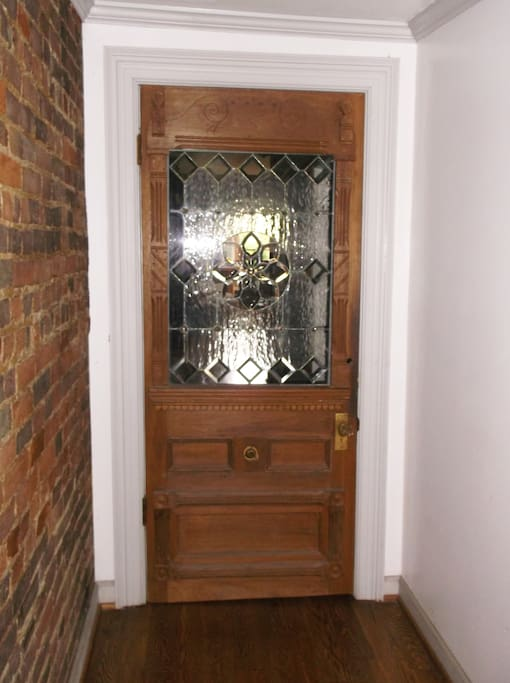 Interior turn-of-the-century entry door with custom leaded glass design.