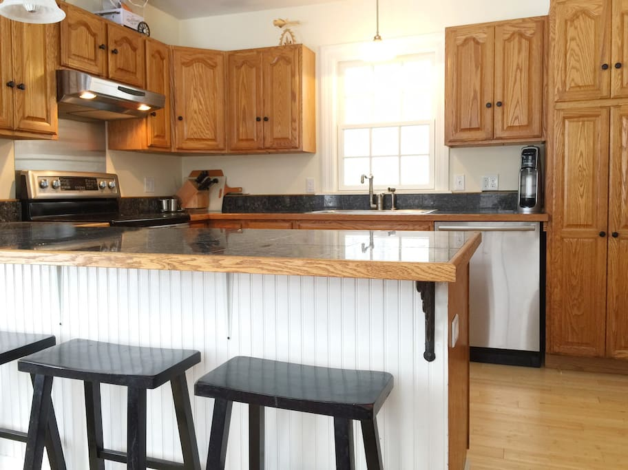 Kitchen with 4 barstools.