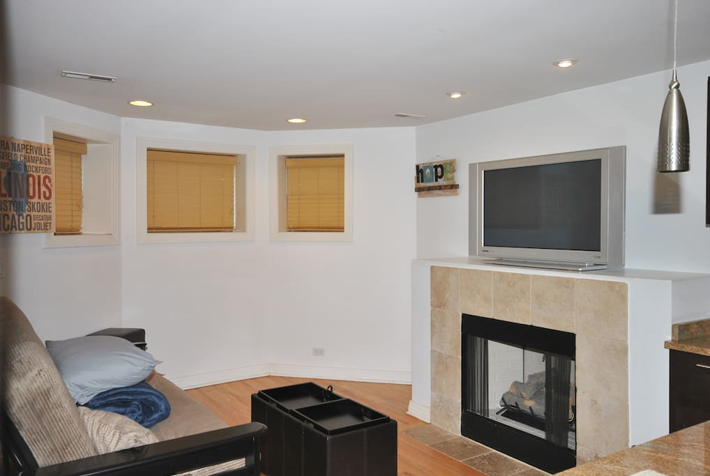 Living room with hardwood floors and gas fireplace.