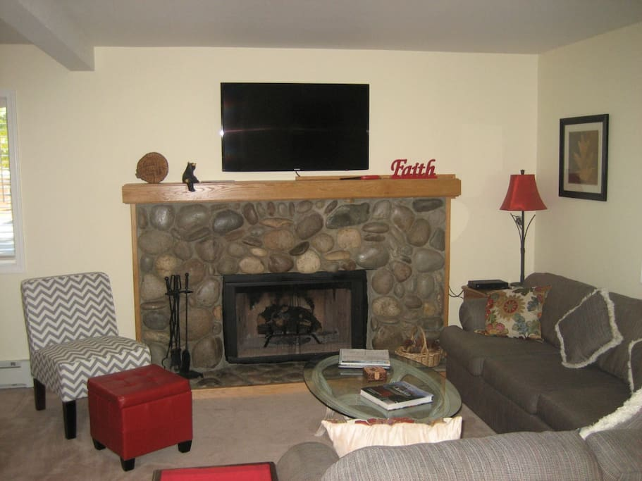 Flat screen tv over fireplace.