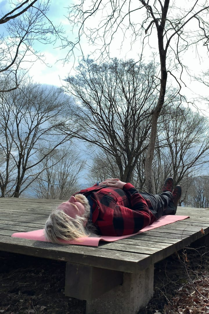lying on the wood deck