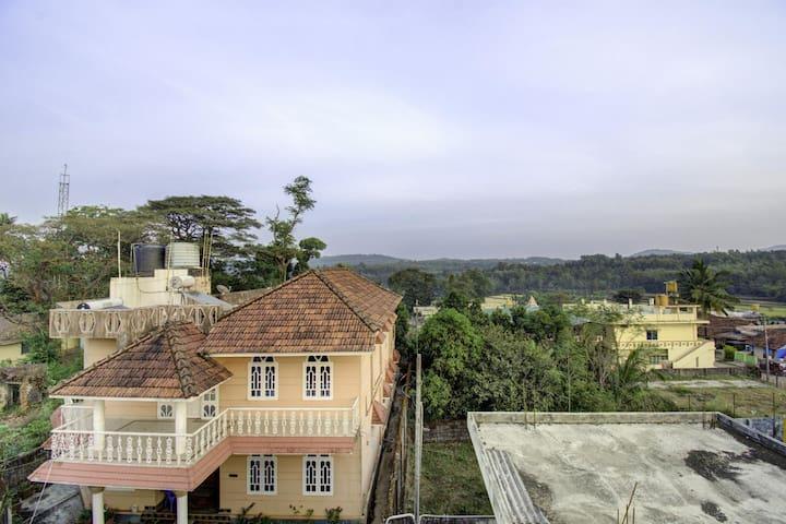 OYO 1BR Garden View Home | (100m) Basaweshwara Temple