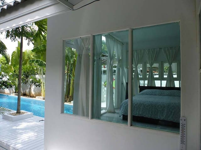 Get up in the morning, open the glass panels and jump right into the pool from the master bedroom!