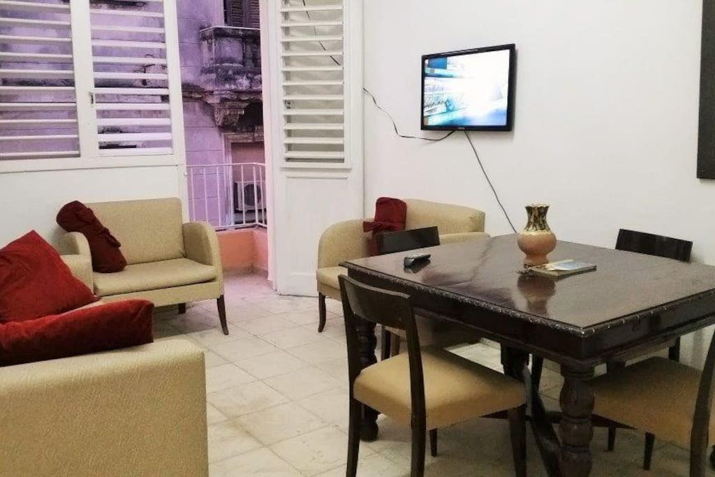 On  this pick you can see a glance of the mixed famous Cuban architectonics from the balcony. The dinner area is a part of the living room.