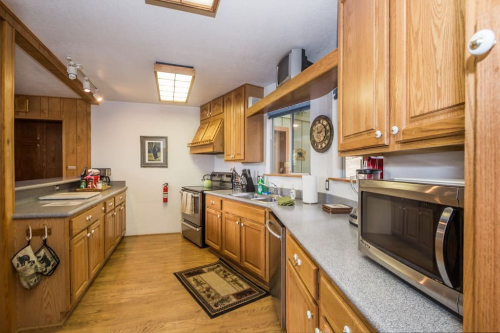Your fully equipped kitchen with lots of counter space, dishes, pots & pans and utensils.