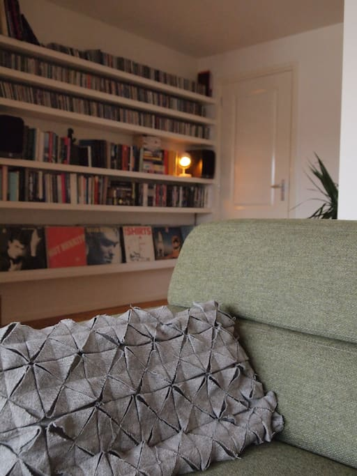 Living room with a nice indie selection of books, music (cd and vinyl) and movies.