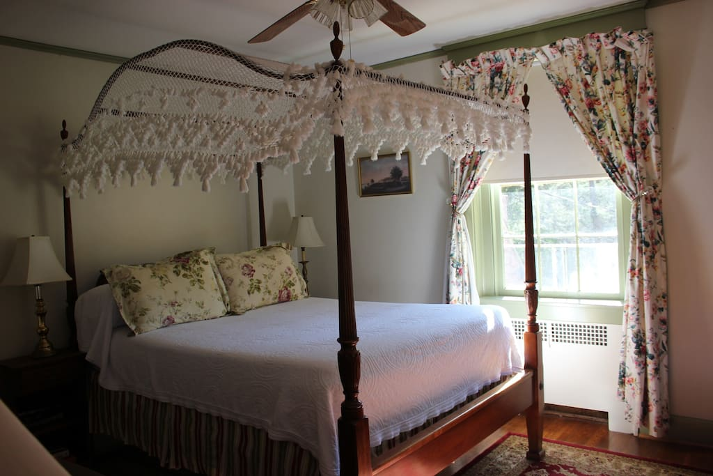 A lace canopy covers the bed in this sweet room