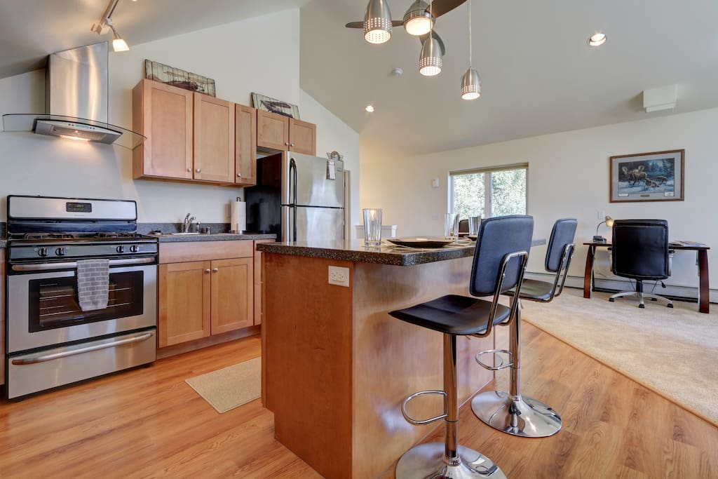 New stainless steal appliances with breakfast bar seating