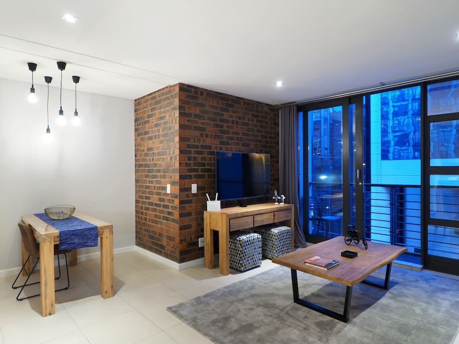 Our livingroom is spacious yet cozy.  Enjoy some peace in the heart of the city buzz