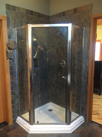 Standing shower also in the bathroom.