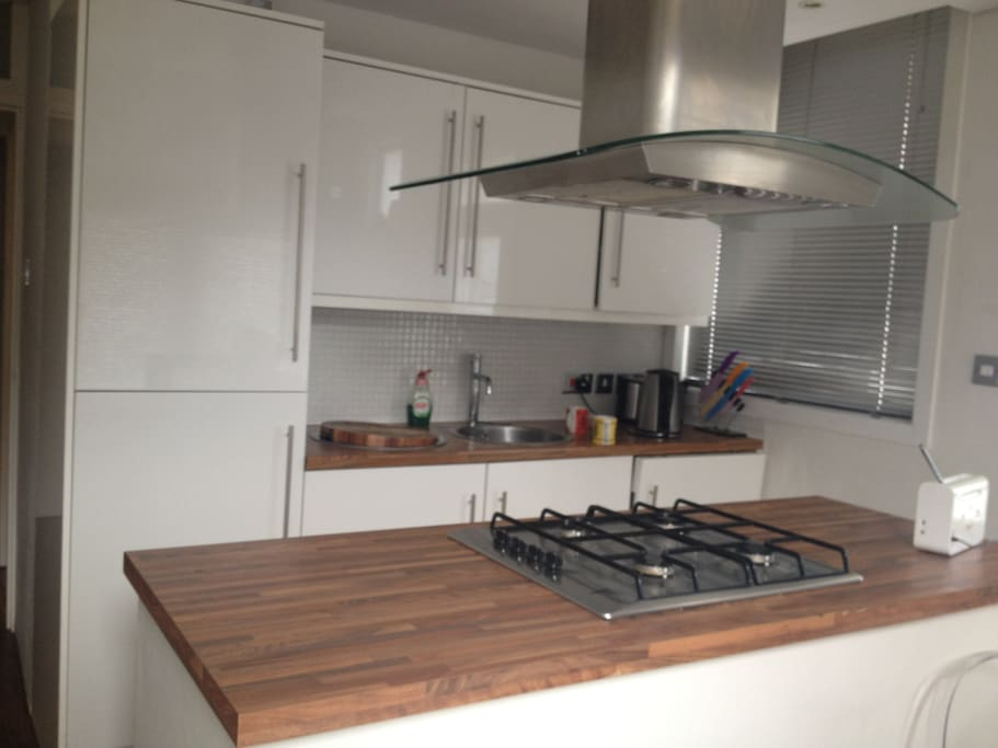 Kitchen with dishwasher and all utensils provided