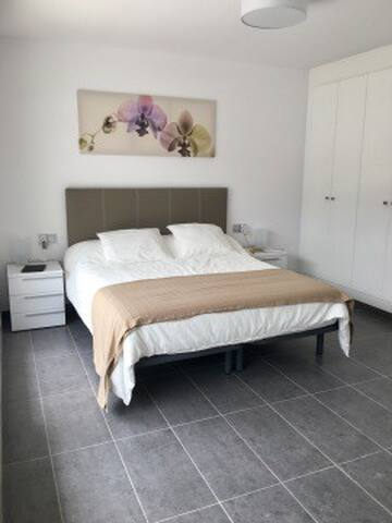 Master bedroom with double bed, balcony and en-suite bathroom