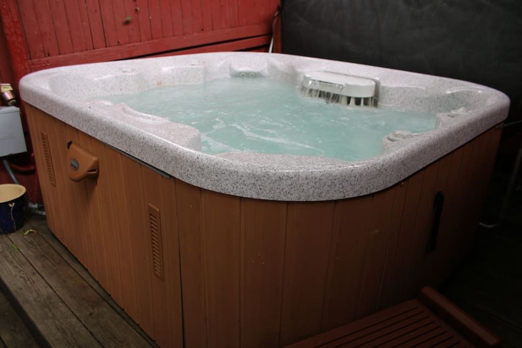 Relax in the hot tub and have a glass of wine.