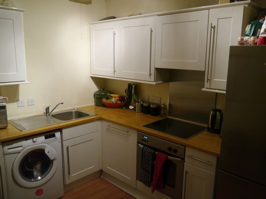 Small, but well equipped kitchen including washing machine, dishwasher large fridge/freezer and microwave.