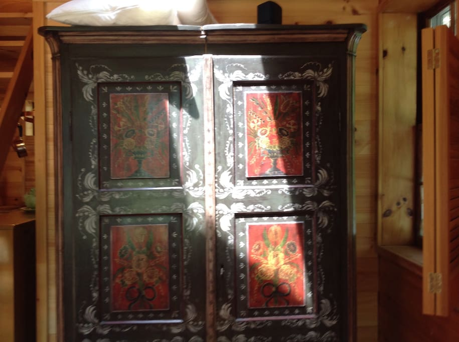 Antique armoire to store your clothing and gear.