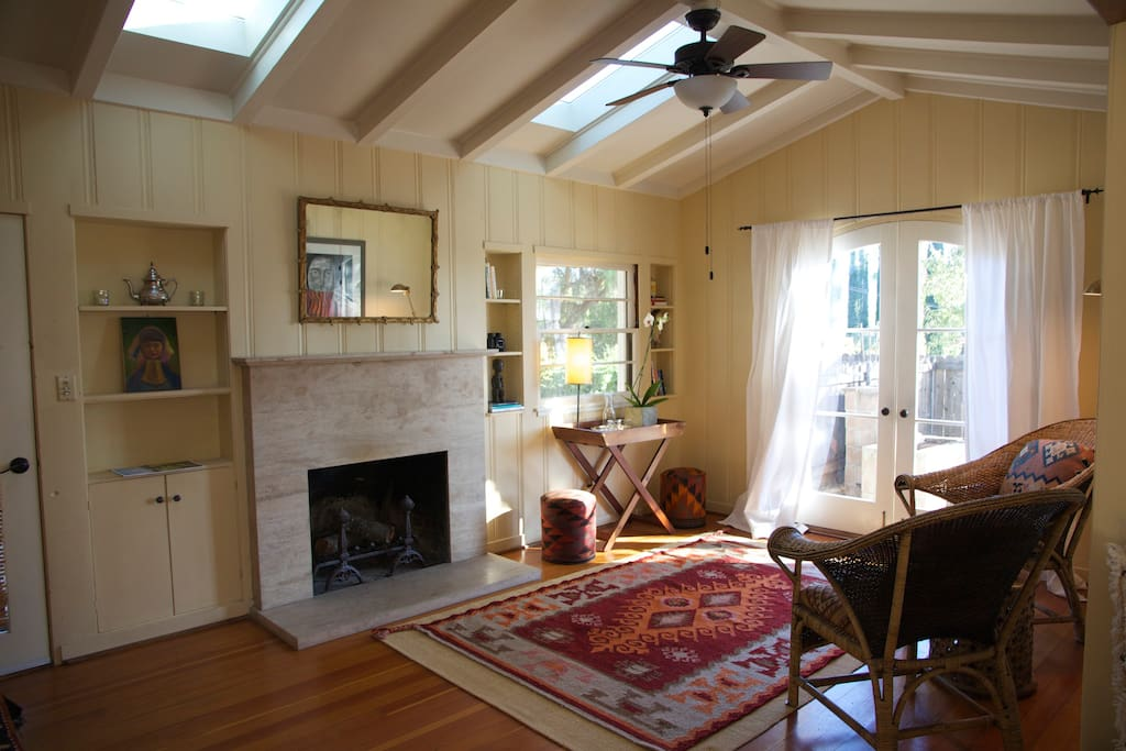 The open living room is full of natural light during the day.