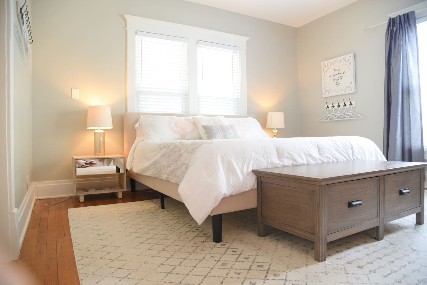 Beautiful Kingsize Master bedroom.  Our guests love the Barn door, decretive fireplace and the simple yet classic design of this space.  You will sleep so comfortabley on this high end mattress and linens.