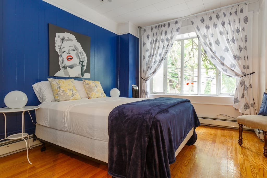 "Your blue room has sealy posturepedic queen size mattress for a soft touch to your back, fluffy blanket and sunny room in the morning. ""Sleep in with Marilyn"" (first bedroom - sleeps 2 guests)"