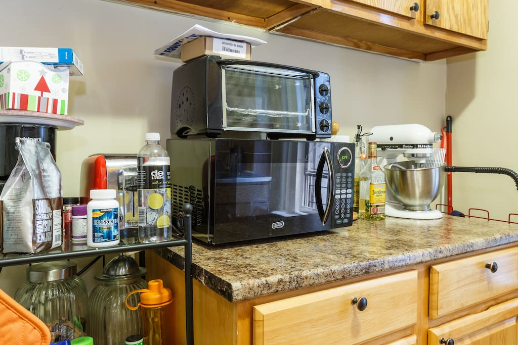 Microwave, toaster oven and kitchen aid mixer.