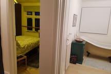 View from hallway on top floor with adjacent bathroom