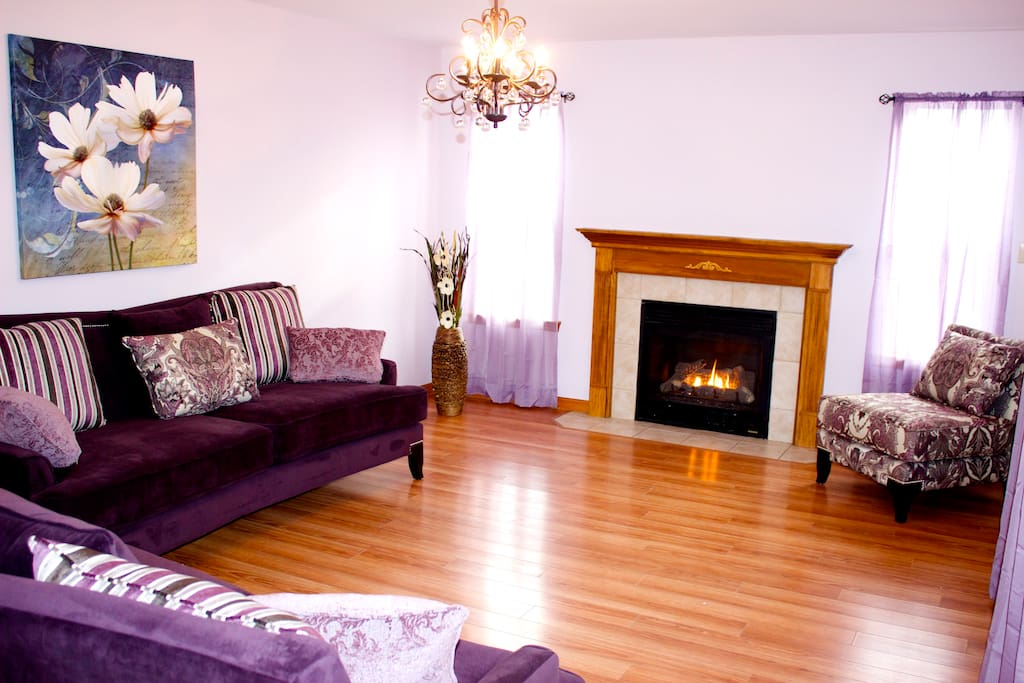 Beautiful living room with a gas fireplace bright and sunny