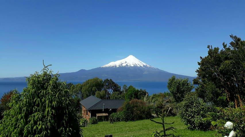 Cómoda habitación en casa frente a Volcán y Lago.