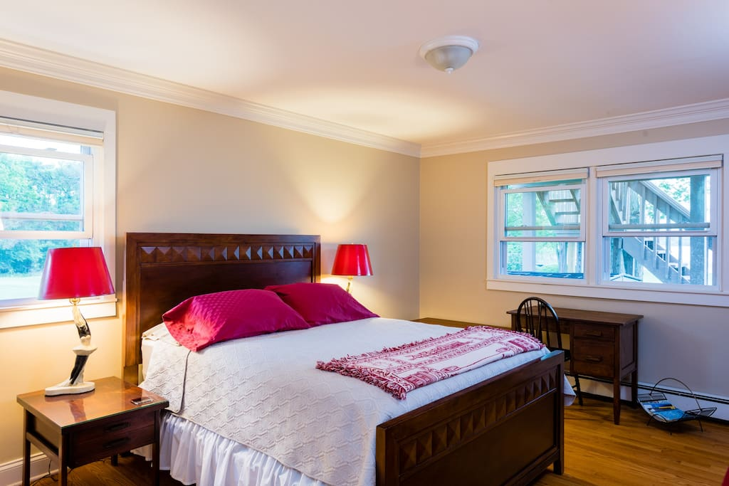 Spacious bedroom with queen bed and private bathroom
