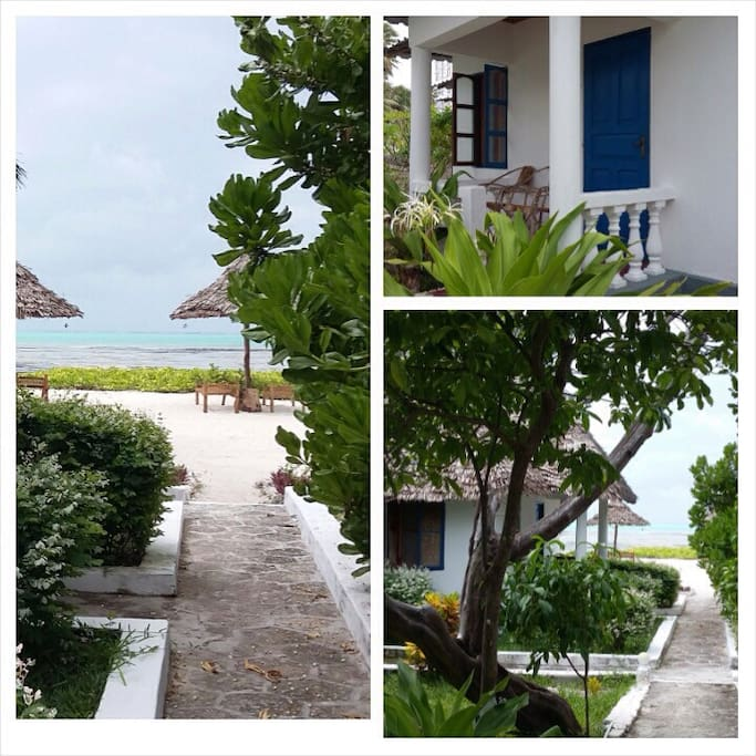 View of rooms and walkway to beach