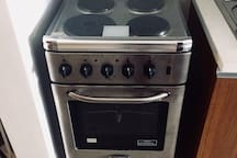 A 4-electric burner stove oven