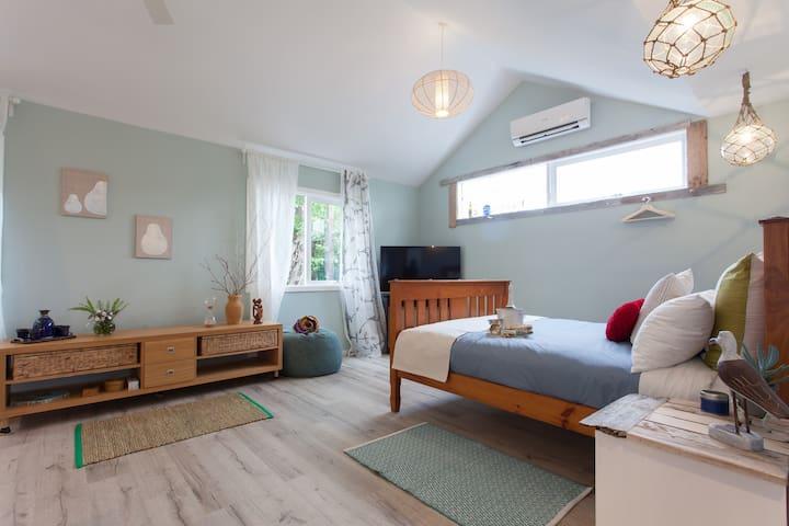 Bedroom overlooks a private garden