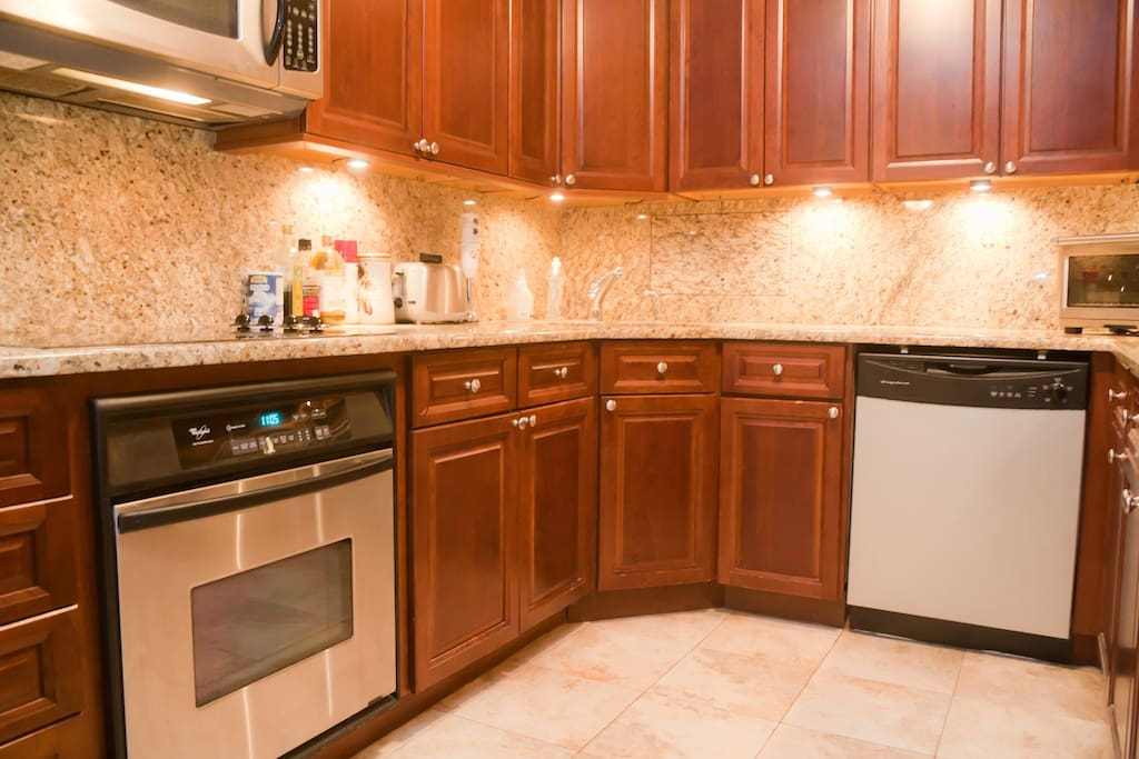 Kitchen:  Granite Countertops, Stainless Steel Appliance, Dishwasher, Microwave, Blender, Juicer, Toaster Oven.