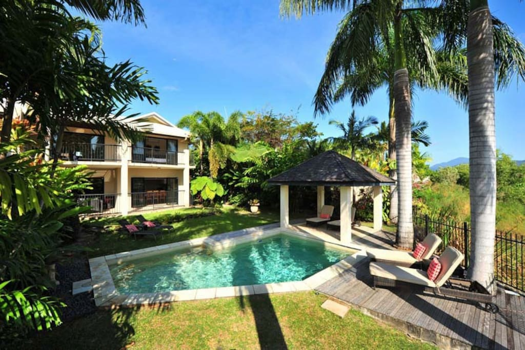 The Villa with Pool area and lounges.