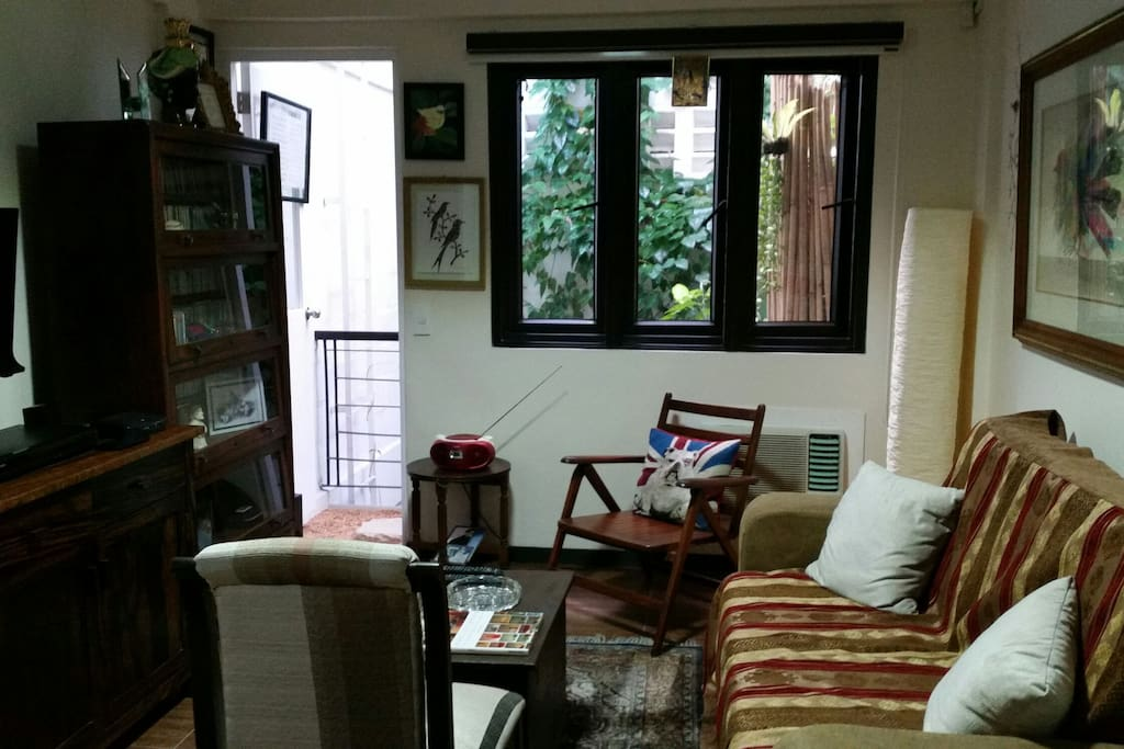 The 2nd floor room has a pull out couch, an entertainment system, 2 hp airconditioning unit, artworks by masters and a small balcony