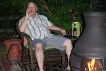 Smoking allowed at one of two outdoor fireplaces.  No other smoking areas are possible of ANY material.  Our home is IN a woods with narrow gravel lane, secluded and so smoking (and not leaving fire-pit until cool to the touch) is a must.