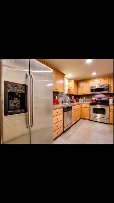 Stainless appliances include microwave, dishwasher, refrigerator.  Front loading washer and dryer (not pictured). Tile backsplash and granite countertops complement maple cabinetry with craftsman details.