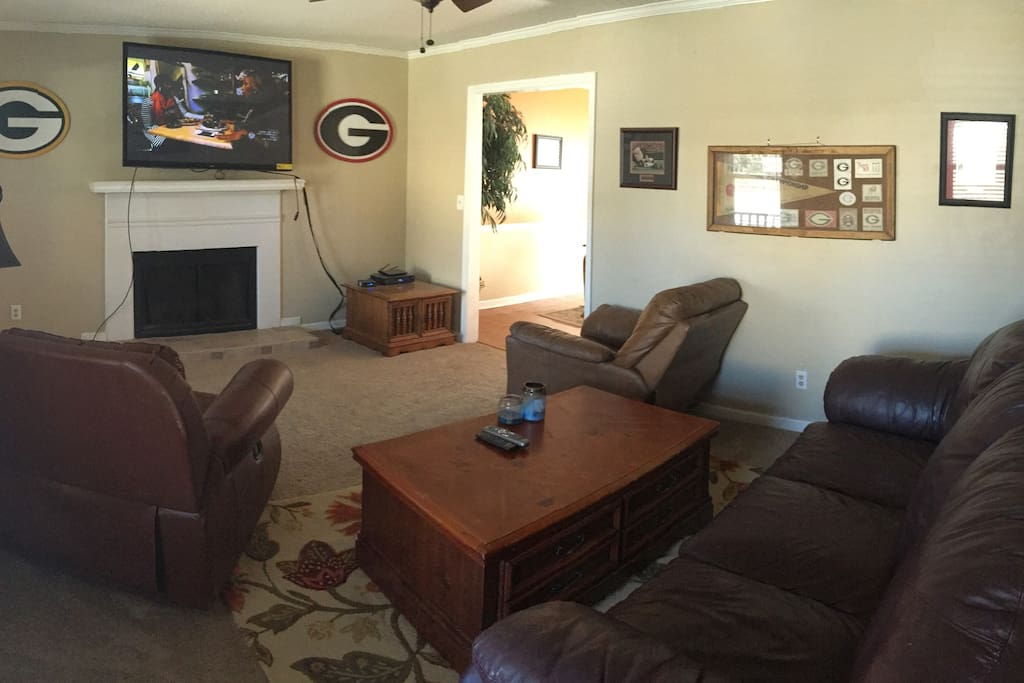 2 Recliner chairs, large sofa, and 60 inch LCD, queen air mattress (if requested)