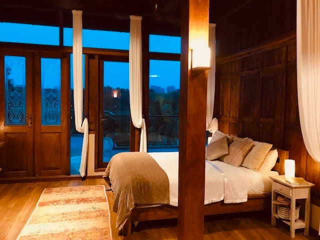 Master Bedroom upstairs opens to balcony with full lake view