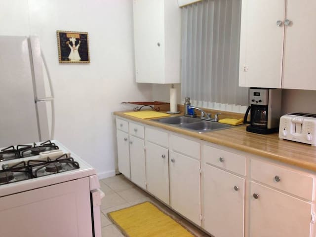 Large kitchen with lots of storage.  Fully stocked with dishes, pots&pans, coffee pot, etc.
