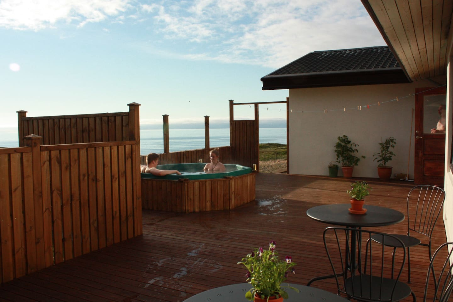 Large veranda with a hot tub and sea view