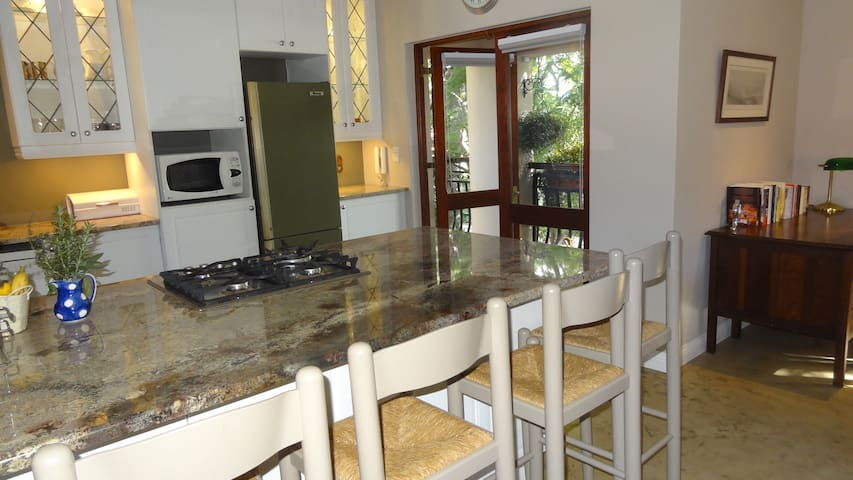 Fully equipped kitchen opening onto the balcony patio