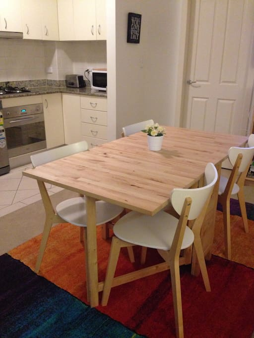 Table can be folded down at one or both sides to create more space