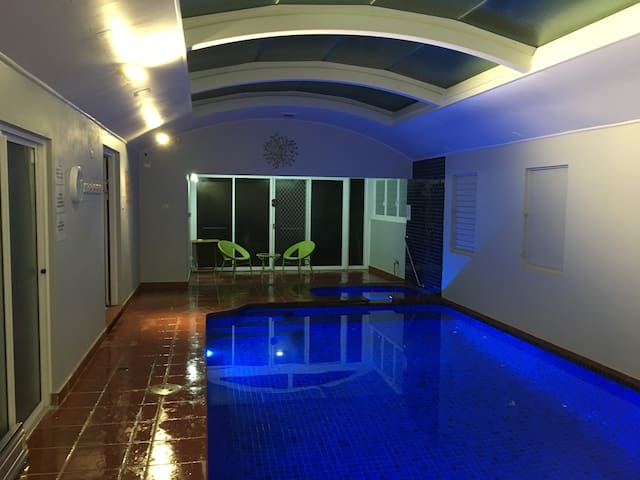 Night time Swimming pool with underwater blue lights