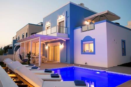 Seabreeze villa beach front luxury - heated pool