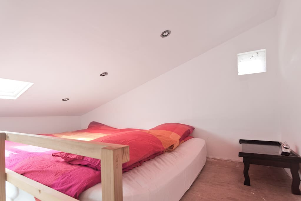 Cosy bed with bedstand