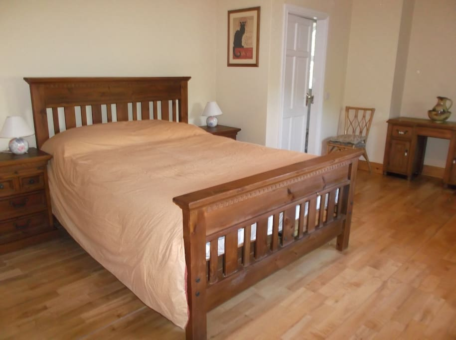 The room is a spacious ensuite double room with wooden floors.