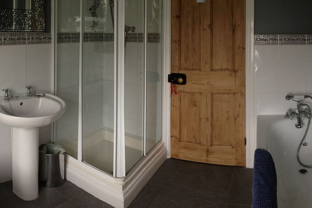 Room 3's ensuite full bathroom, with shower, bath, toilet and basin.