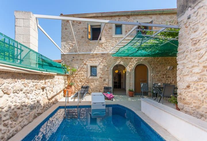 The architect's stone village home.