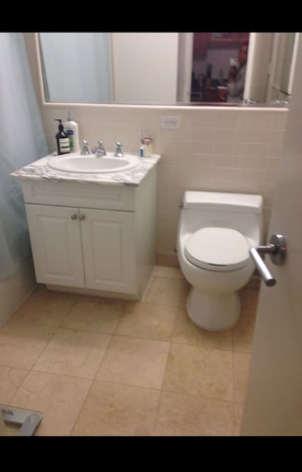 Beautiful clean bathroom, marble floors with bathtub and shower